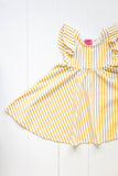 Ruffle twirl dress in yellow stripes