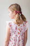 Ruffle twirl dress in strawberry floral