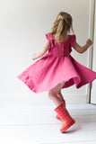 Ruffle twirl dress in Berry pink