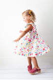 Ruffle twirl dress in Hummingbird Garden