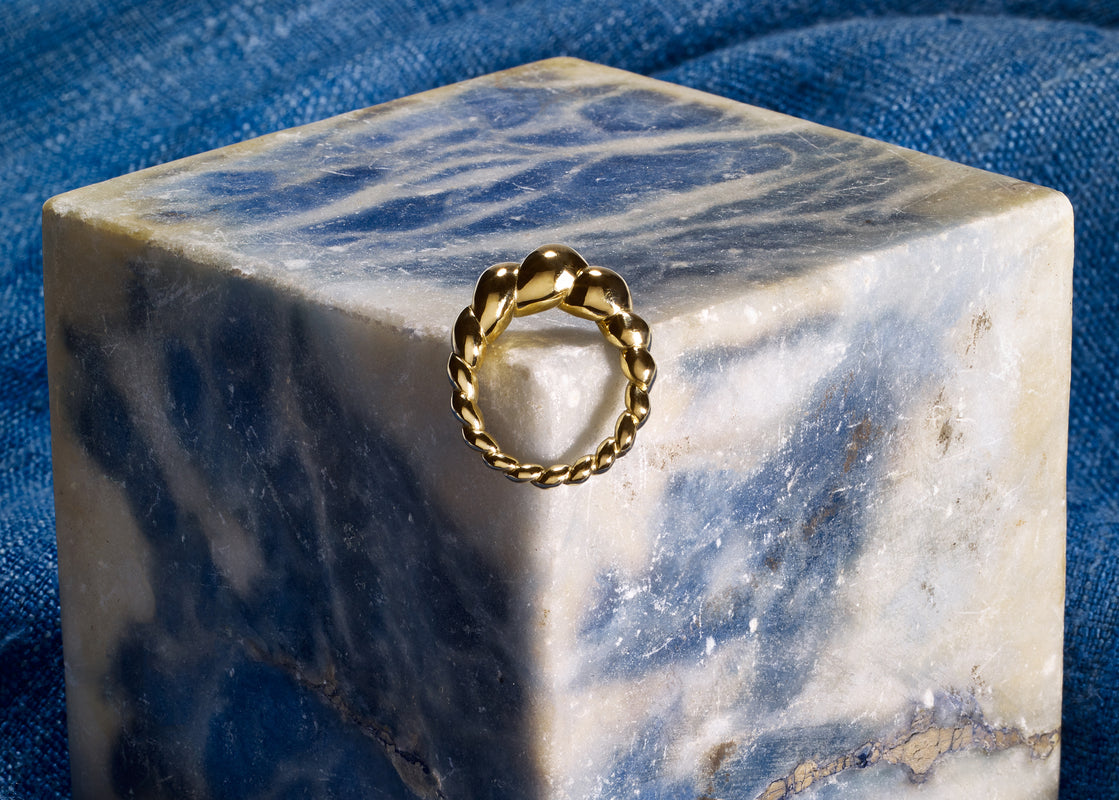 Gold ring on marble stone