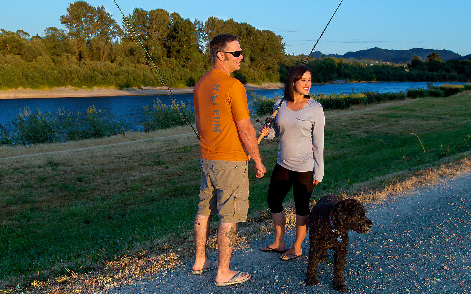 Man and woman wearing haeleum insect repellent clothing to go fishing at dusk