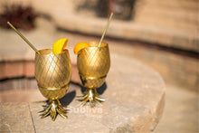 Two Gold Pineapple Cups on Table Outside | Great Present Ideas | Present Pal