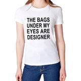 The b@gs under my eyes are designer Slogan - Bold and Beautiful