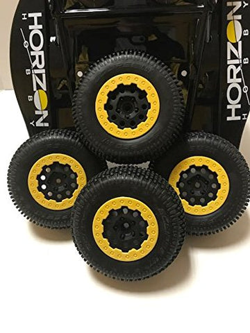 LOSI XXX-SCT GREAT PERFORMING TIRES AND WHEELS. THE YELLOW REALLY MAKES YOUR TRUCK STAND OUT. FITS MANY LOSI TRUCKS. YOU GET 8 TOTAL TIRES AND WHEELS, 2 FULL SETS.