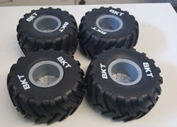 AXIAL 1/10 GRAVE DIGGER TIRES, THESE TIRES MAKE ANY TRUCK LOOK FANTASTIC, WITH THE WHITE LETTERING TO HELP THEM STAND OUT by AXIAL