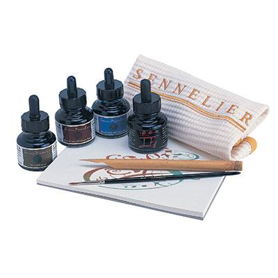 "Cardboard boxed calligraphy set comprising 1 bamboo pen, brush, and 4 colours (Cobalt Blue, Walnut, Sepia and Black), plus a 7×7"" calligraphy pad."