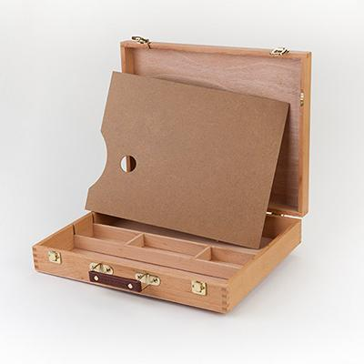 The travel box comes in a beautiful oiled beech finish with partitioned areas for brushes and art supplies.