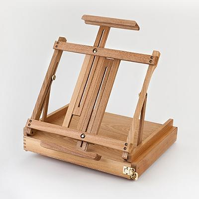 The oiled beech tabletop easel has a partitioned slide out drawer and extendable easel arms