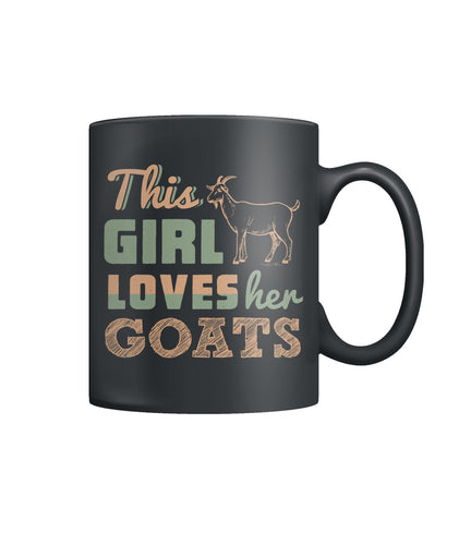 This girl loves her goats