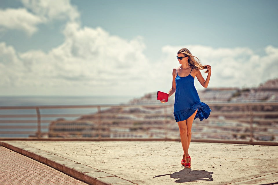 woman in blue dress with red heels walking