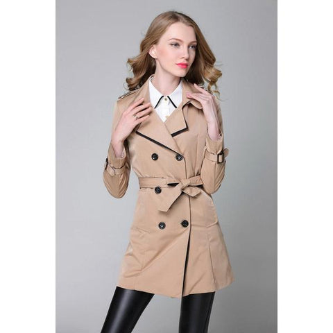 lady in trench coat posing