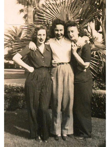 Women wearing high waist wide leg trousers in 1940s