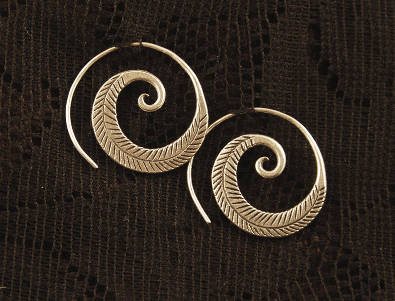Tribal silver spiral earrings, feather leaf design