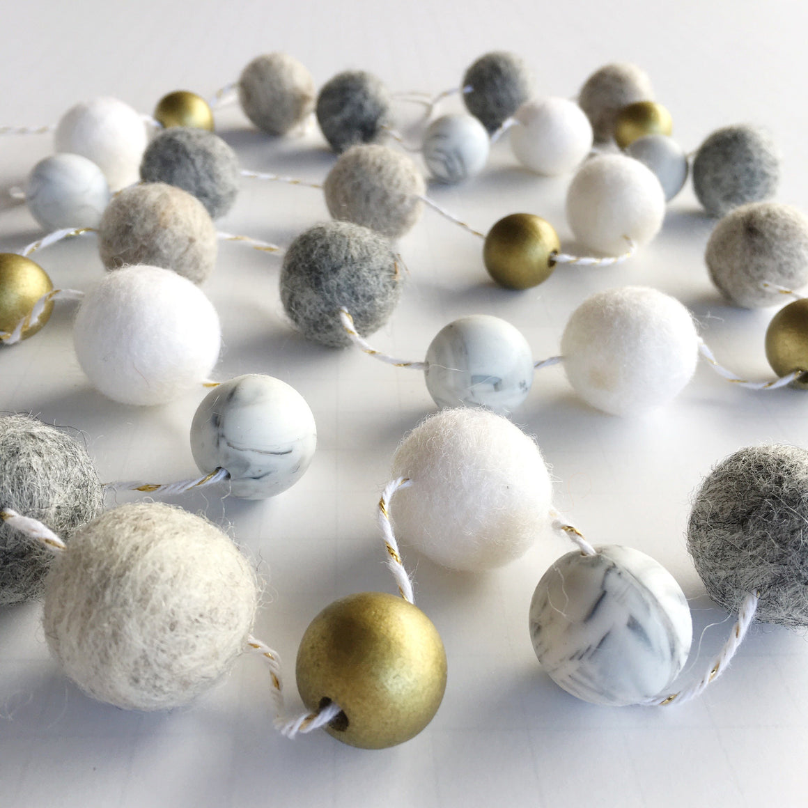 FELT BALL GARLAND - ORO, Felt Pom Garlands, BON + CO - Bon + Co. Party Studio