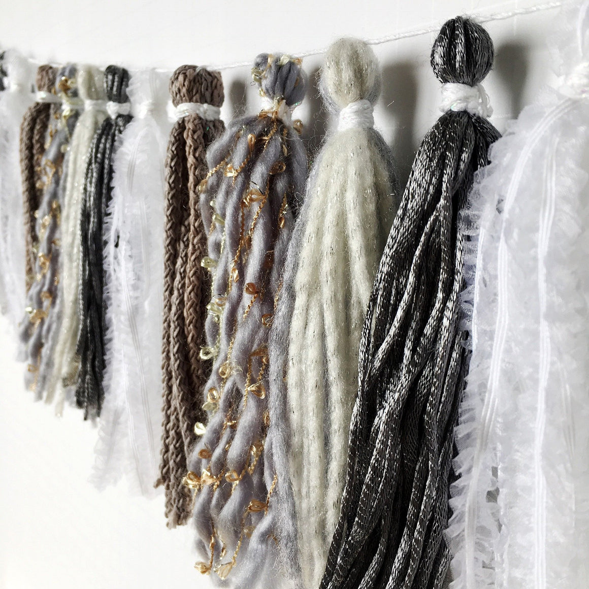 TASSEL GARLAND - FABRIC MIXED SILVER LUXE
