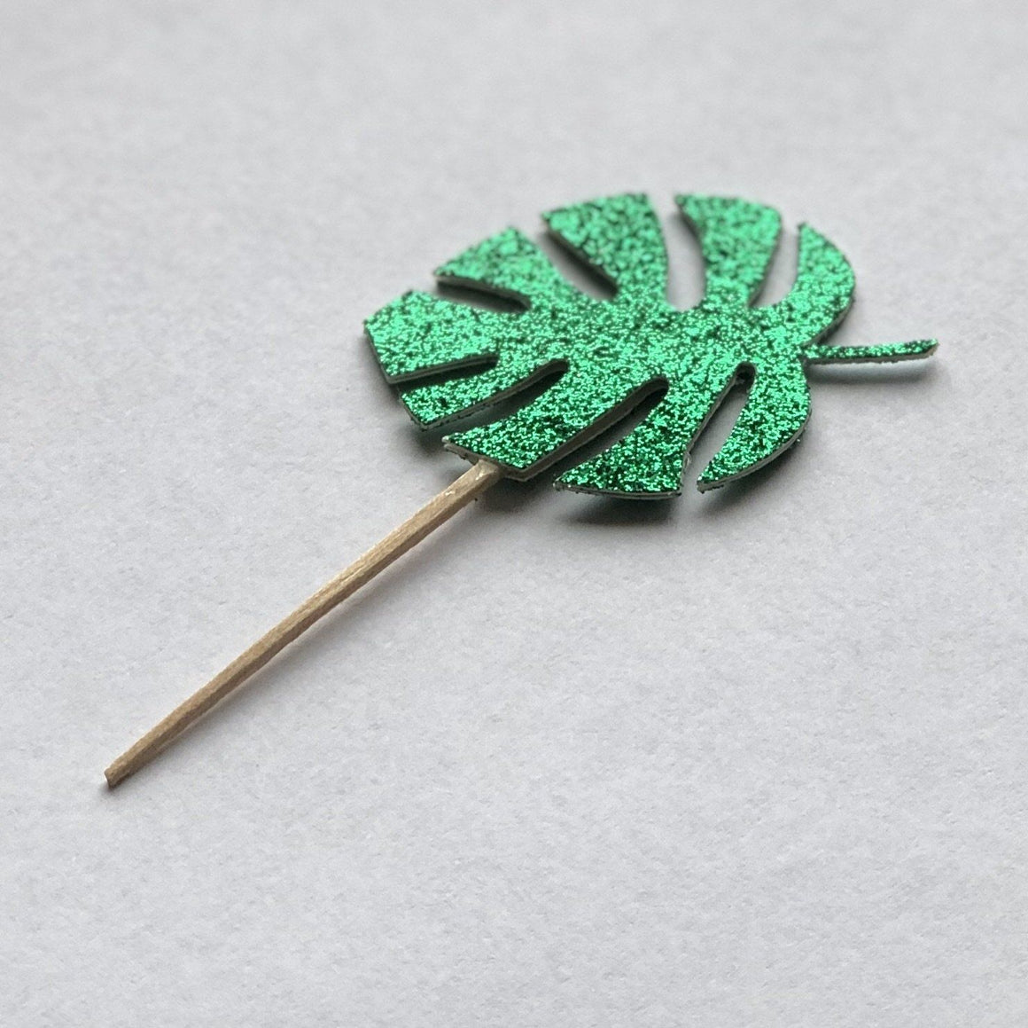 PARTY PICKS - MONSTERA TROPICAL LEAF GREEN 2-SIDED, Picks + Toppers, BON + CO - Bon + Co. Party Studio