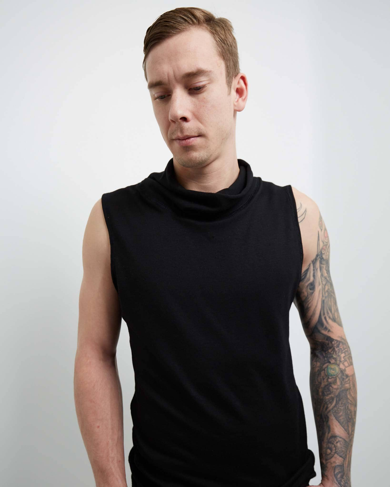 Men's designer tank top made with stretchy black fleece