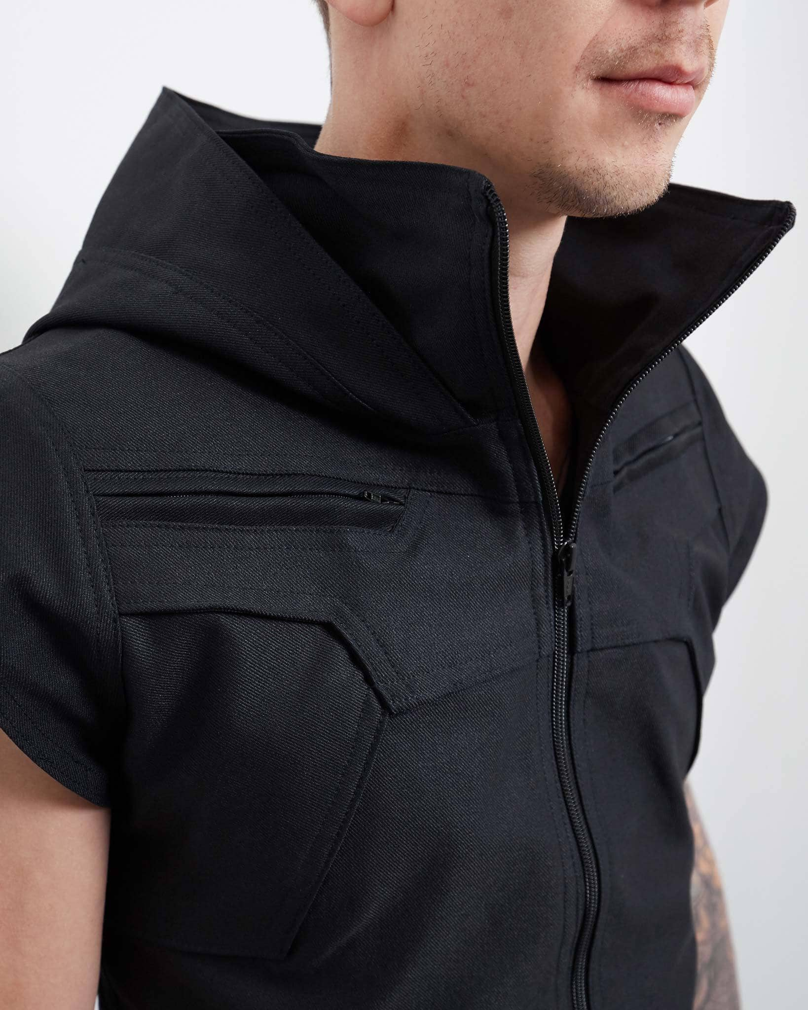 mens modern style vest with four pockets, zipped entry and deep hood