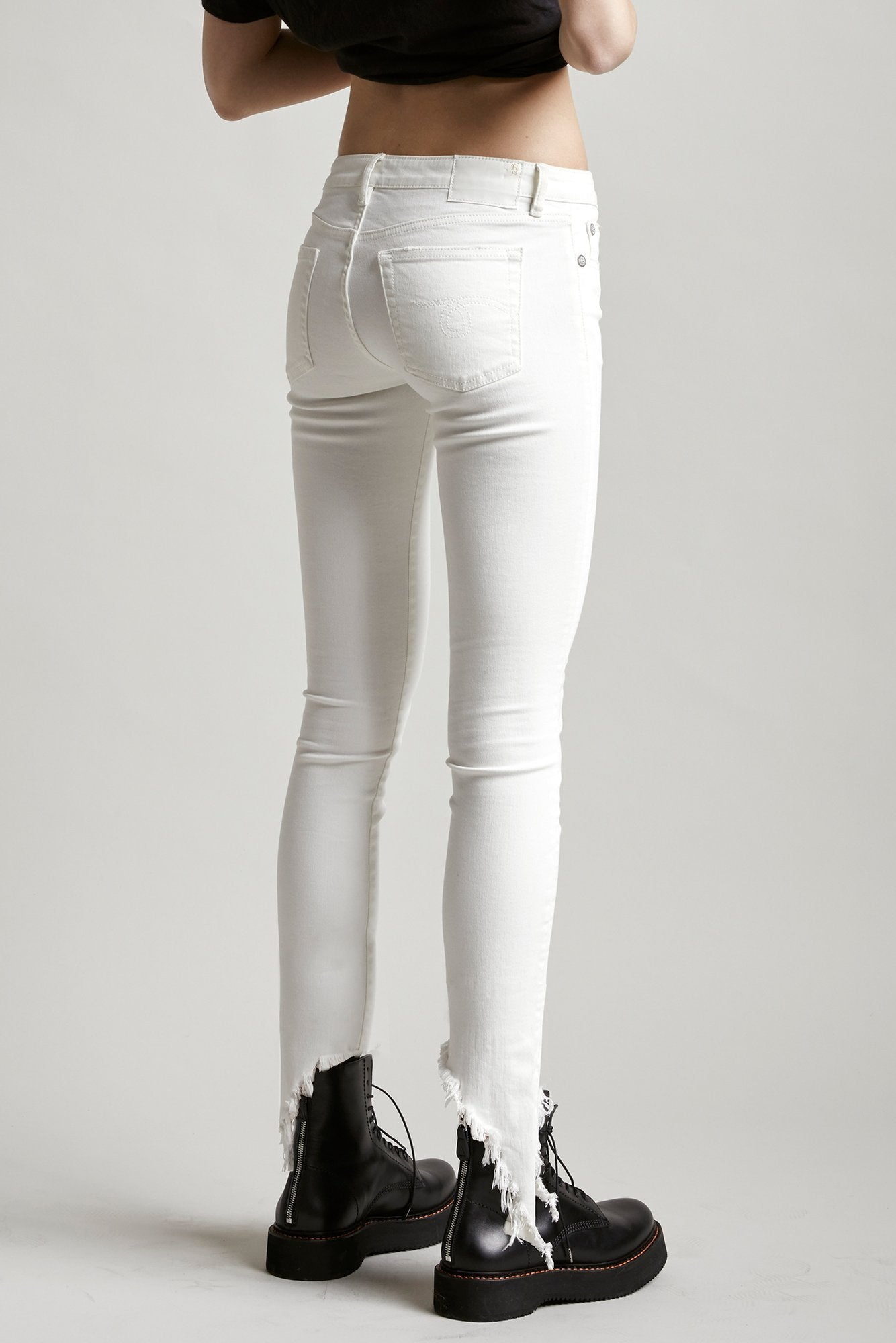 R13 Denim Kate Skinny tight low rise jean in white with angled hem