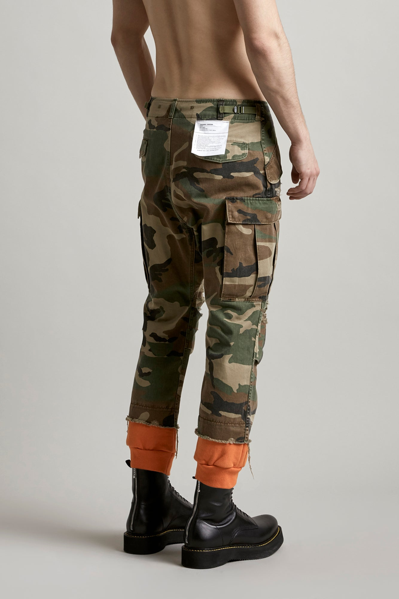 R13 classic cargo pant with orange sweatpant cuff with slight distressing at knee in camo