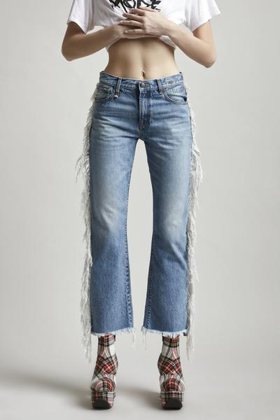 r13 Denim mid rise straight leg cropped jean with fringing on the side seam in a light blue wash