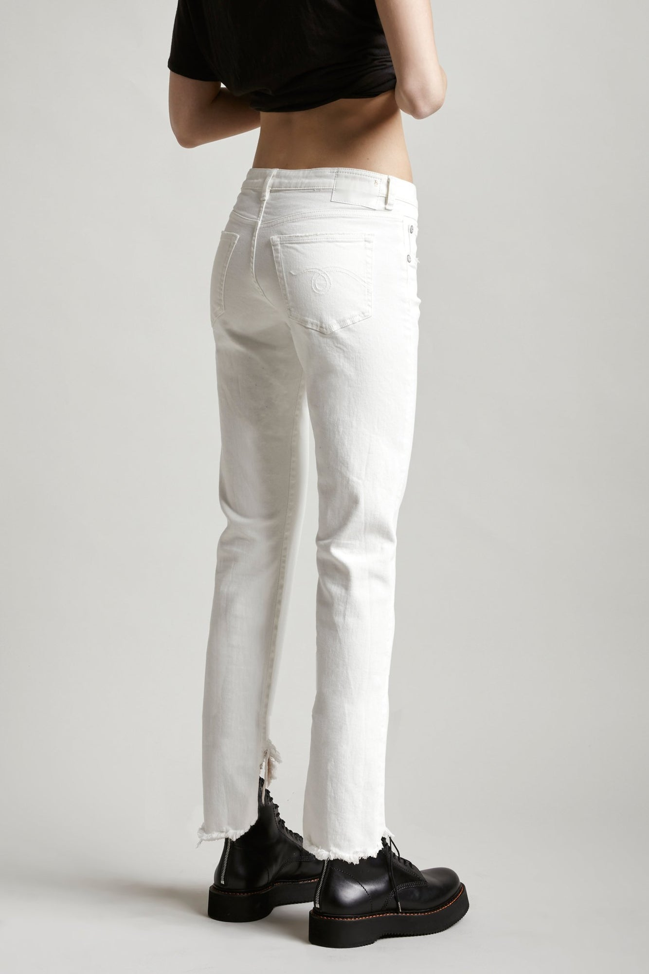 R13 Denim boy straight mid rise jean in white with distressed angled hem