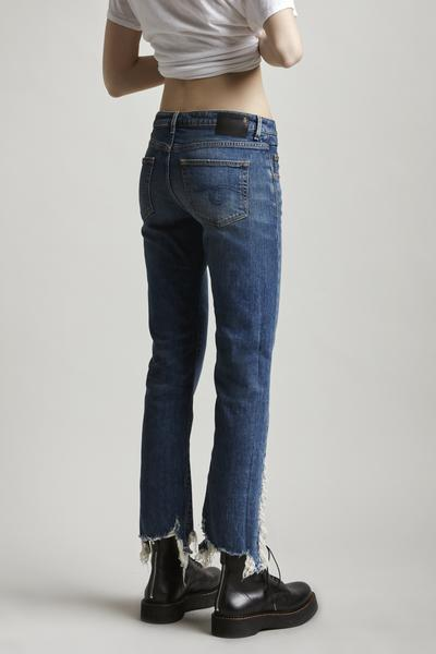 R13 Denim low rise straight leg jean in medium blue was with distressed hem feature