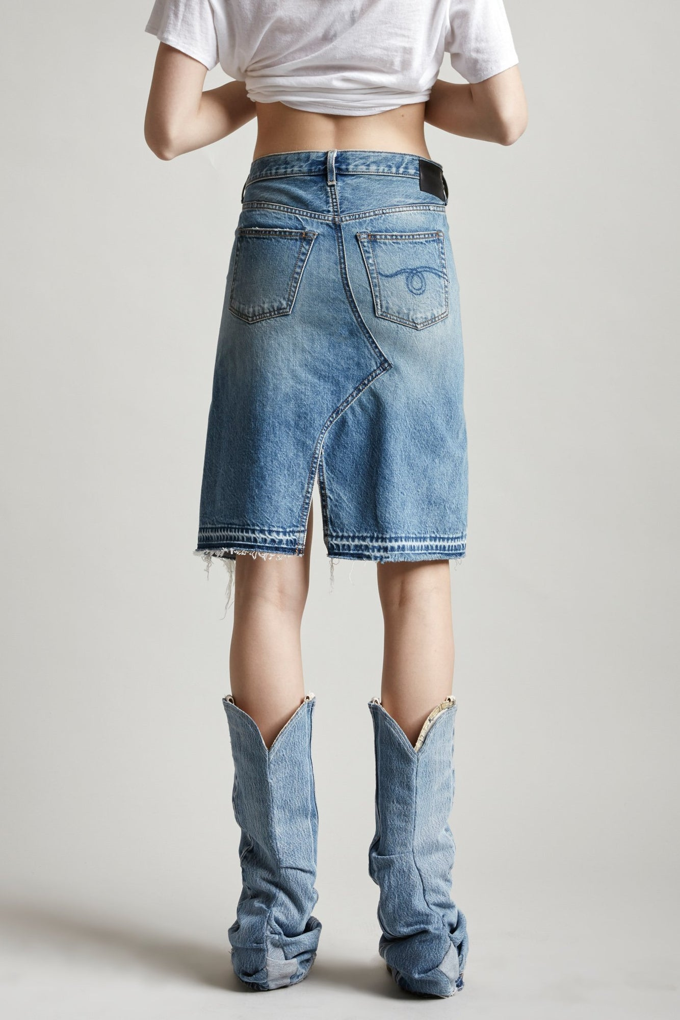 R13 denim short denim skirt with shredded split up the middle in light blue wash jasper