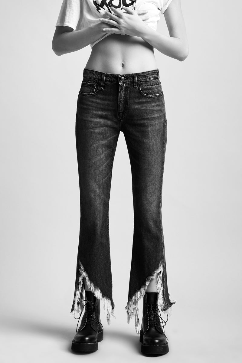 R13 Denim mid rise jeans in washed black cropped fit with slight flare with distressed hem
