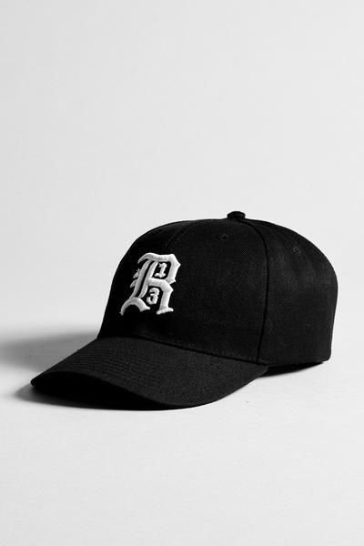 R13 baseball paneled twill cap in black with raised R13 logo and adjustable velcro strap