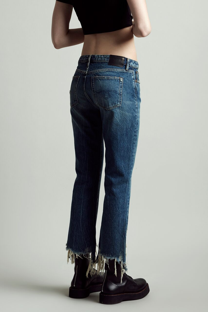 R13 denim mid rise spiral kick, cropped fit with slight flare and heavily distressed hems in blue wash kelly