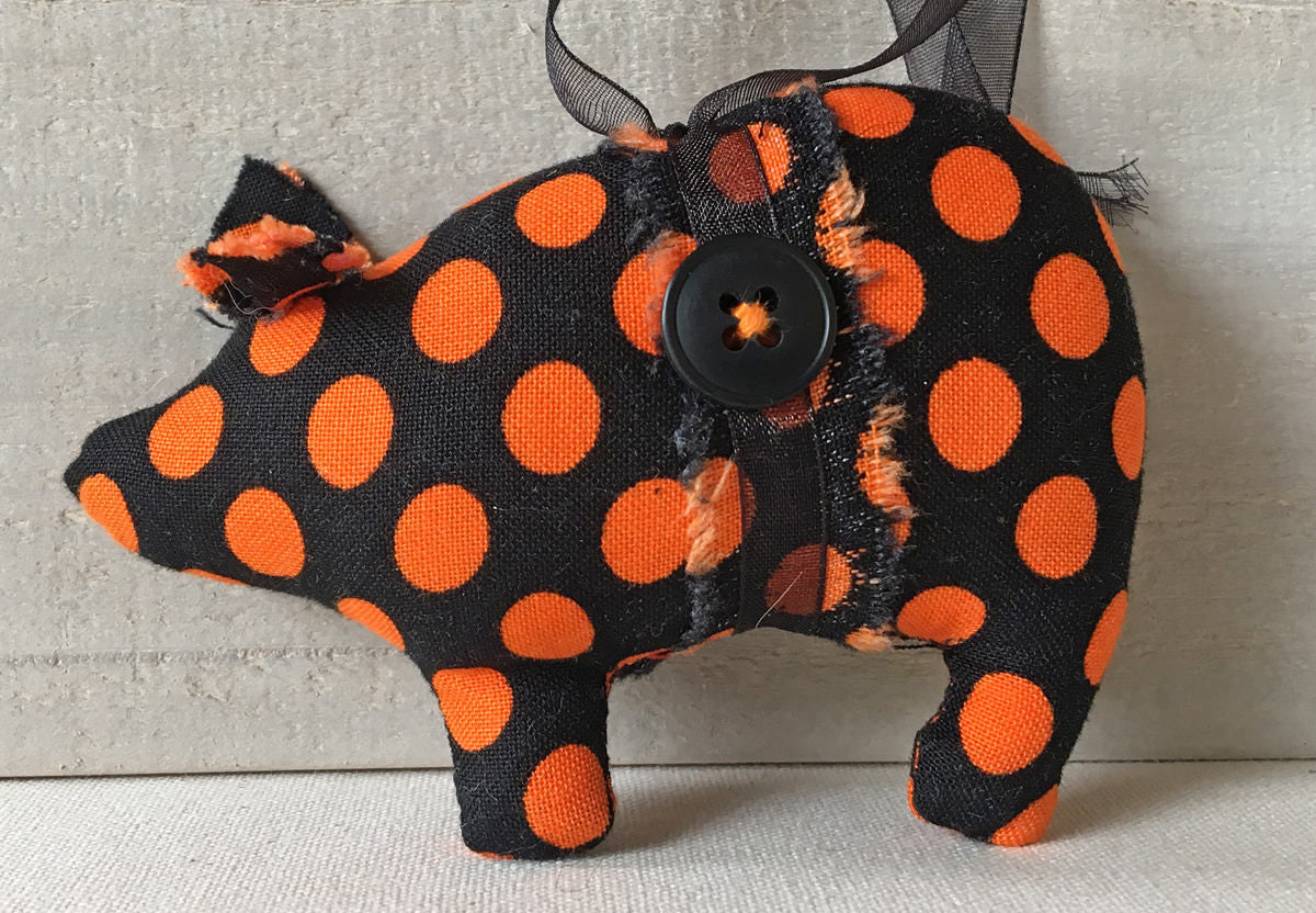 black and orange polka dot pig
