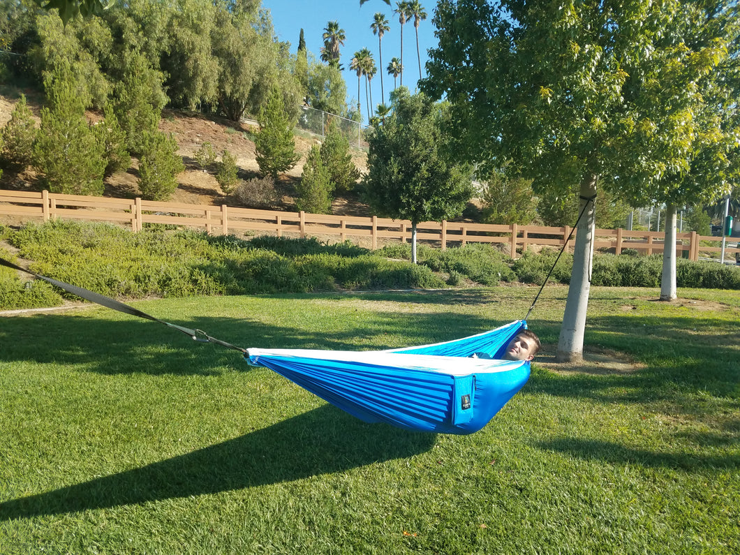 aria 2   blue and light blue double hammock hung on trees at a local park aria 2   blue   the best double camping hammock out there      rh   elementaworld