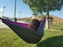 Aria 2 - Gray and Violet double hammock hung on trees at a local park. Basketball court in the background.