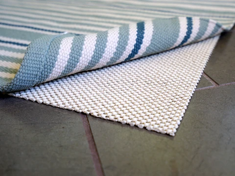 how to get rugs to stay in place on tile floors