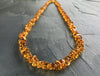 Citrine Necklace on top of a concrete surface