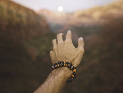Man wearing tiger's eye and earth warrior bracelet