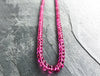 Pink Tourmaline Necklace on concrete surface