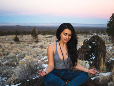 Woman wearing Amethyst Mala
