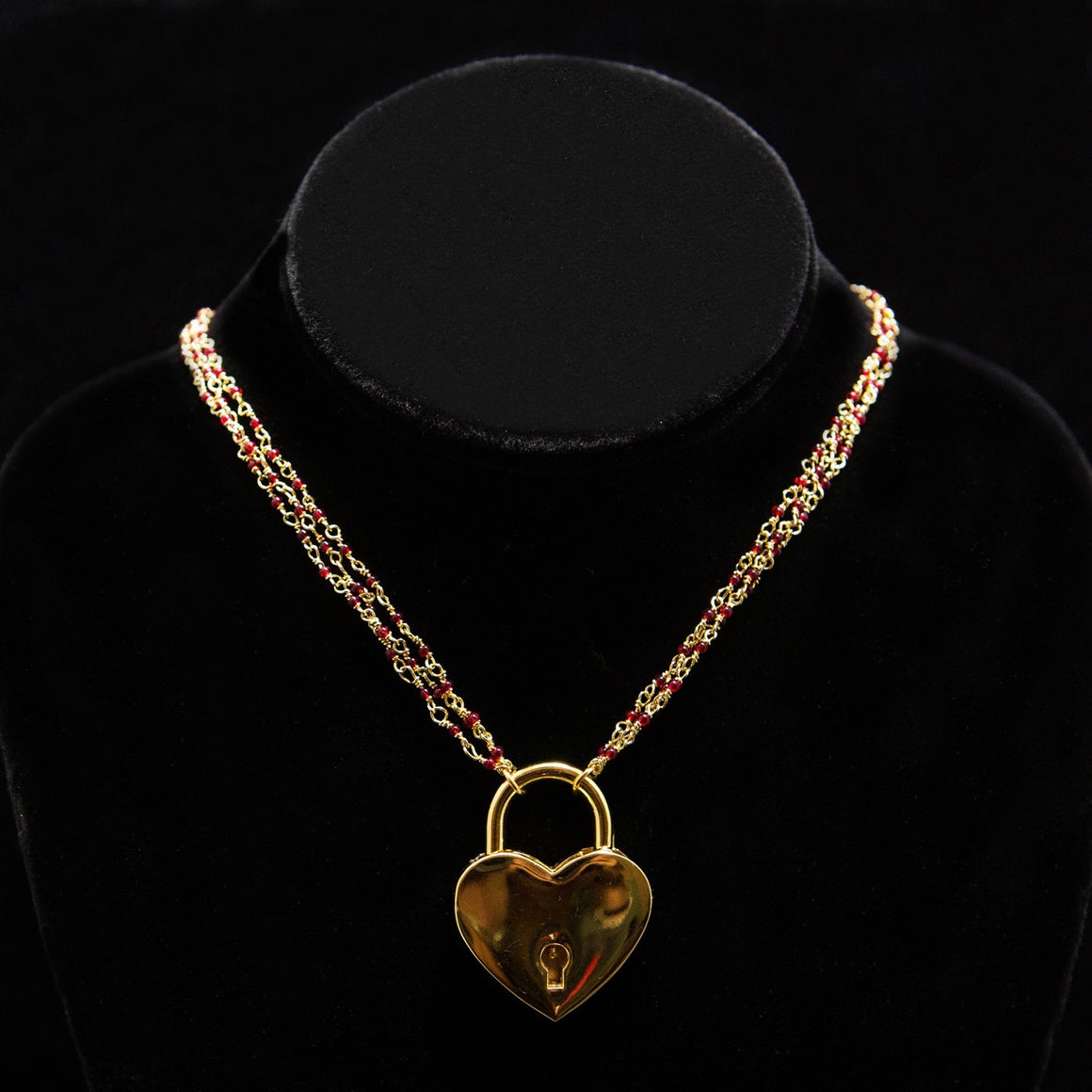 Day Necklace: Triple Gold Chain with Ruby-Red Beads and Large Heart Lock