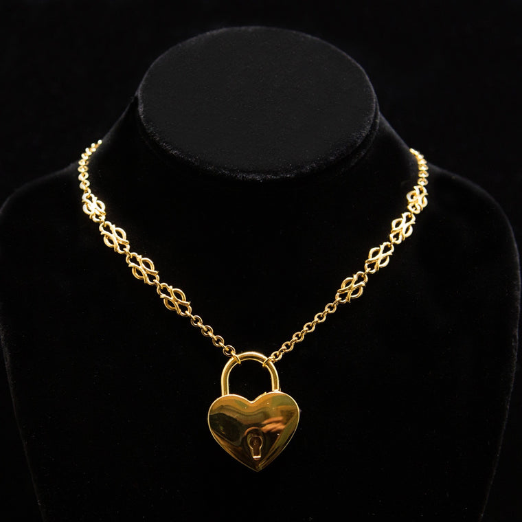 Day Collar: Gold Chain with Ornamental Stations and Large Heart Locket