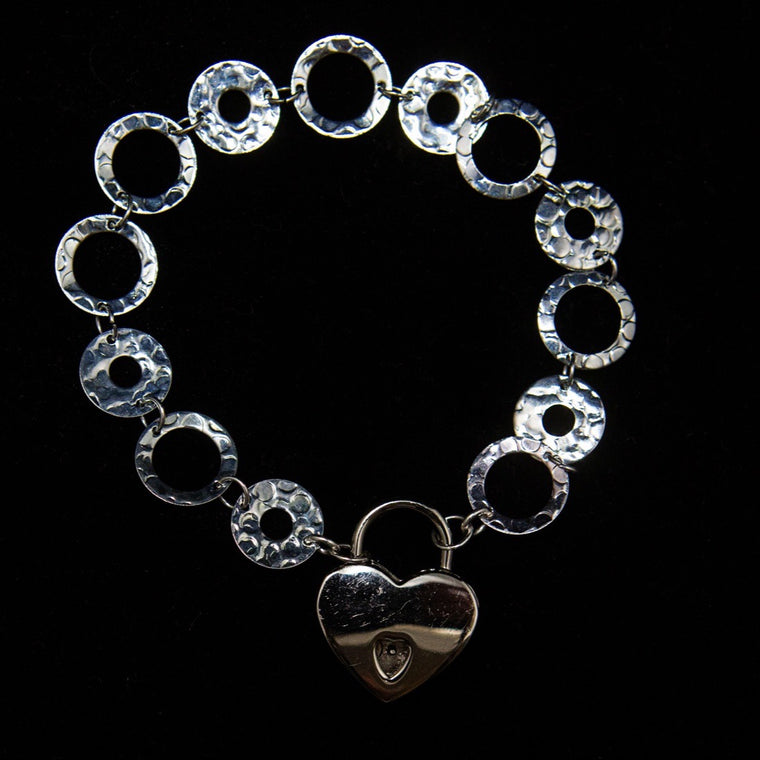 Bracelet: Sterling Silver Hammered 'O' Rings with Heart Locket