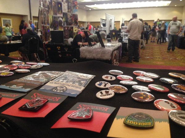 Monsterologist cryptozoological paranormal embroidered patches & buttons merchandise table at Cryptid Con 2017 in Frankfort, Kentucky