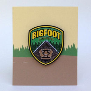 Bigfoot Patrol park ranger shield enamel pin