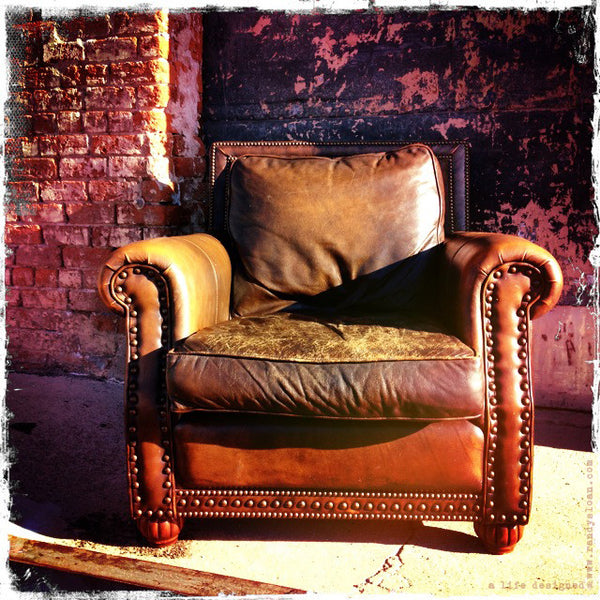 distressed leather club chair sold by a life designed