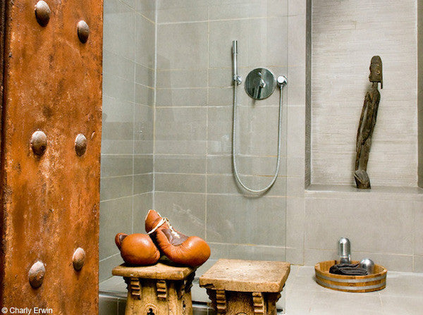 industrial style bathroom with vintage decor accents boxing gloves