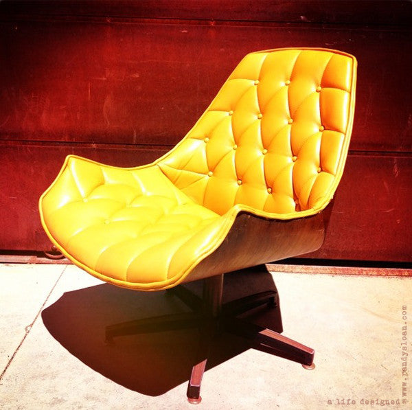 yellow plycraft swivel chair sold by A Life Designed