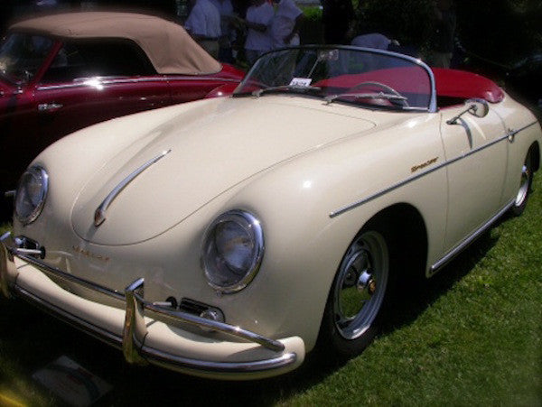 creme colored 356 porsche speedster with red leather interior
