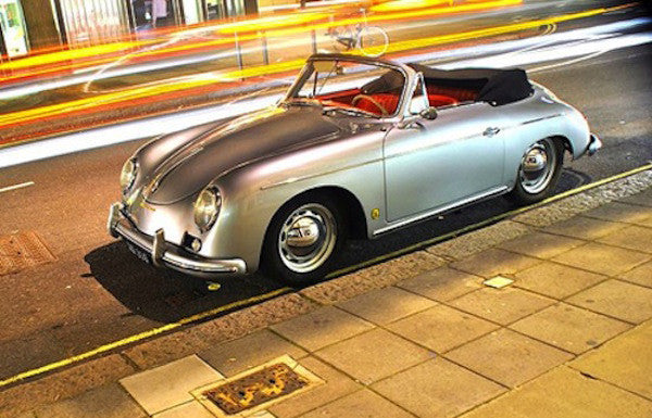 silver colored 356 Porsche speedster with top down